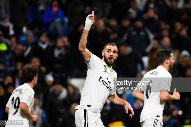 TOPSHOT Real Madrid's French forward Karim Benzema celebrates scoring the opening goal during the Spanish league football match Real Madrid CF...
