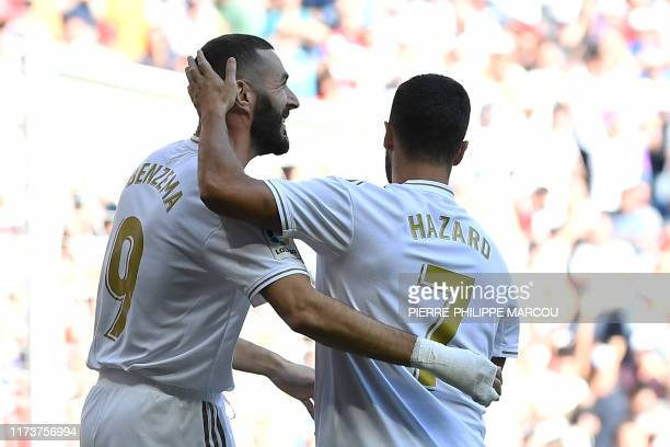 Real Madrid's French forward Karim Benzema celebrates scoring the opening goal with Real Madrid's Belgian forward Eden Hazard during the Spanish...