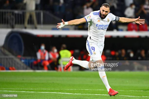 Real Madrid's French forward Karim Benzema celebrates scoring the opening goal during the Spanish League footbal match between Real Madrid CF and...