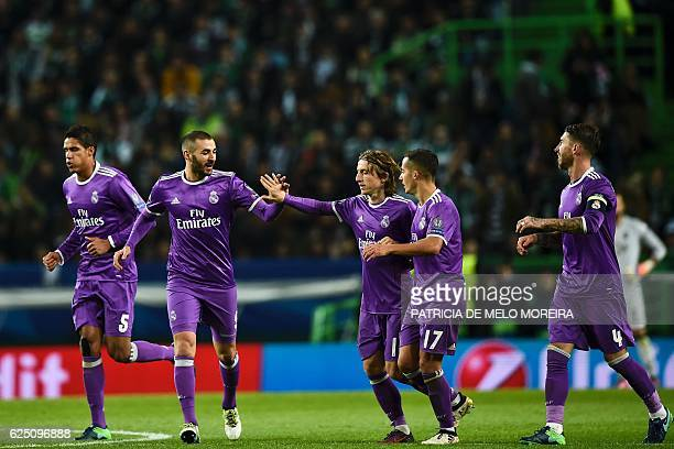 TOPSHOT Real Madrid's French forward Karim Benzema celebrates with his teammate Real Madrid's Croatian midfielder Luka Modric after scoring a goal...
