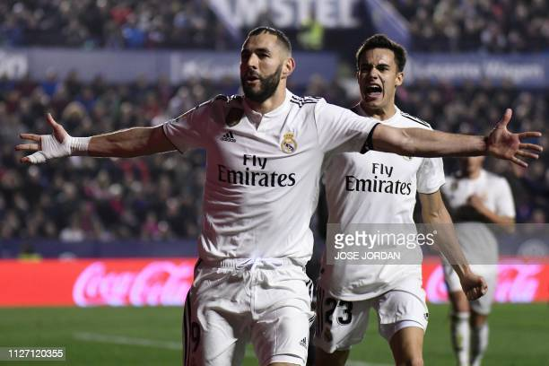 Real Madrid's French forward Karim Benzema celebrates with Real Madrid's Spanish defender Sergio Reguilon after scoring a goal during the Spanish...