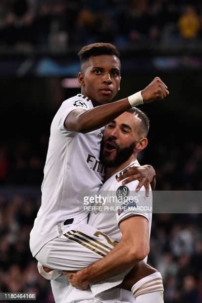 Real Madrid's French forward Karim Benzema celebrates with Real Madrid's Brazilian forward Rodrygo after scoring during the UEFA Champions League...