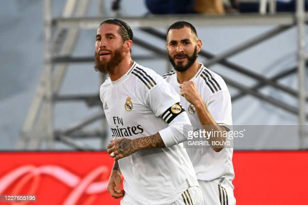 Real Madrid's French forward Karim Benzema celebrates with Real Madrid's Spanish defender Sergio Ramos after scoring during the Spanish League...