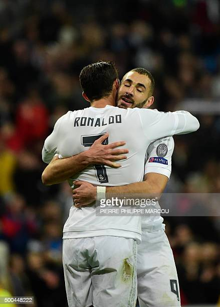 Real Madrid's French forward Karim Benzema celebrates with Real Madrid's Portuguese forward Cristiano Ronaldo after scoring his third goal during the...