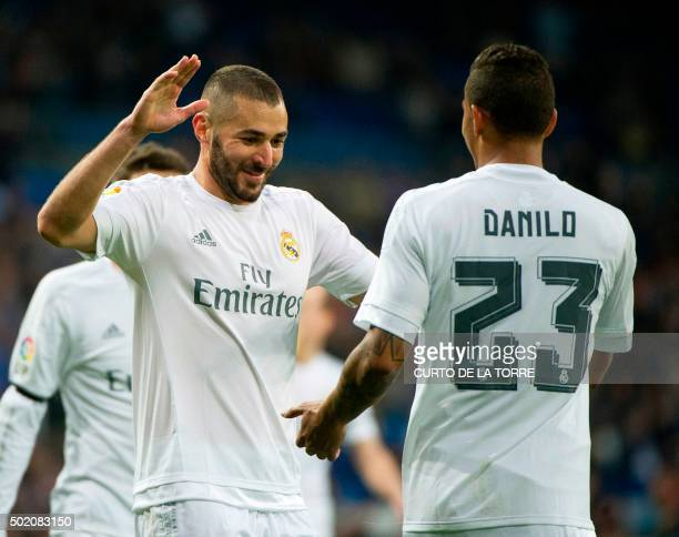 Real Madrid's French forward Karim Benzema celebrates with Real Madrid's Brazilian defender Danilo after scoring during the Spanish league football...