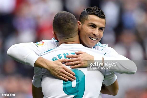 Real Madrid's French forward Karim Benzema celebrates with Real Madrid's Portuguese forward Cristiano Ronaldo after scoring during the Spanish league...