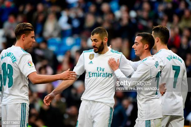 Real Madrid's French forward Karim Benzema celebrates with Real Madrid's Spanish miedfieder Marcos Llorente Real Madrid's Spanish midfielder Lucas...