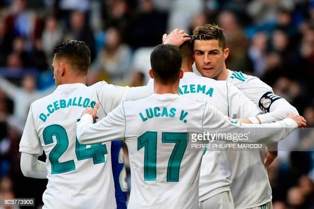Real Madrid's French forward Karim Benzema celebrates with Real Madrid's Spanish midfielder Daniel Ceballos Real Madrid's Spanish midfielder Lucas...