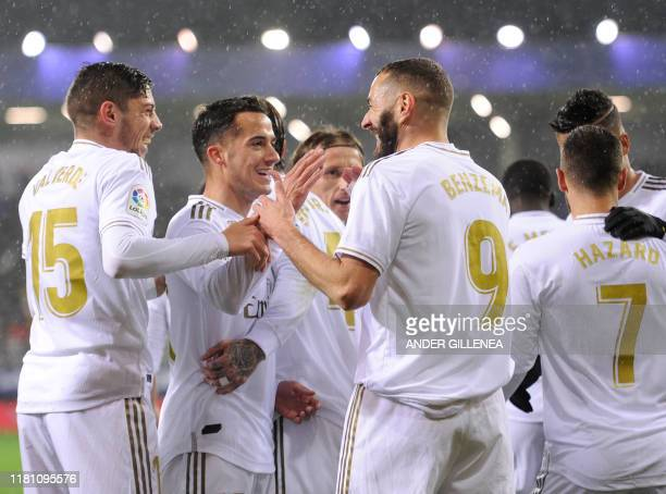 TOPSHOT Real Madrid's French forward Karim Benzema celebrates with teammates after scoring a goal during the Spanish league football match between SD...