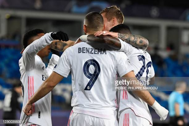 Real Madrid's French forward Karim Benzema celebrates with teammates after scoring during the UEFA Champions League group B football match between...