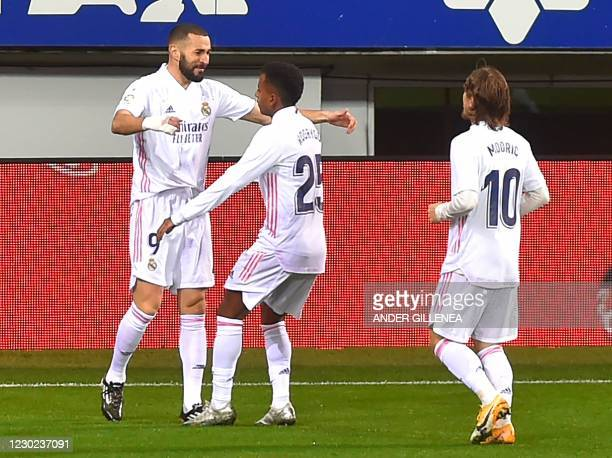 Real Madrid's French forward Karim Benzema celebrates with teammates after scoring a goal during the Spanish league football match between SD Eibar...