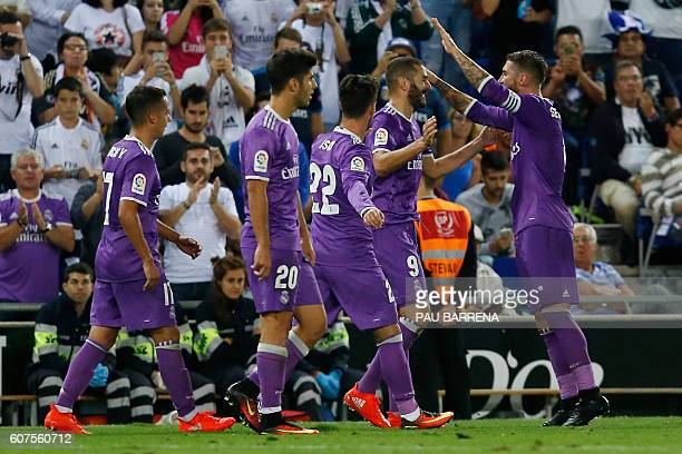 Real Madrid's French forward Karim Benzema celebrates with teammates after scoring during the Spanish league football match RCD Espanyol vs Real...