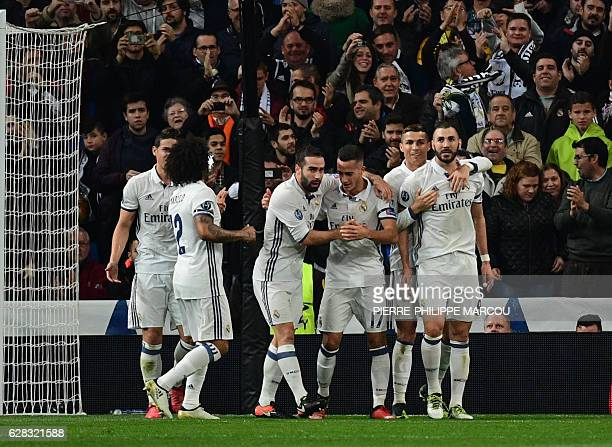 Real Madrid's French forward Karim Benzema celebrates with teammates after scoring a goal during the UEFA Champions League football match Real Madrid...