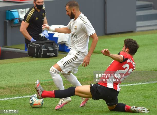 Real Madrid's French forward Karim Benzema challenges Athletic Bilbao's Spanish midfielder Raul Garcia during the Spanish League football match...