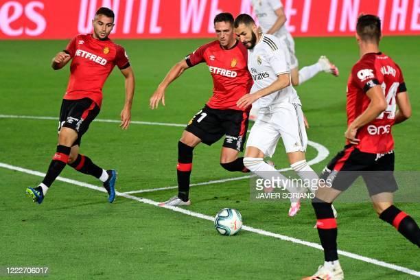 Real Madrid's French forward Karim Benzema challenges Real Mallorca's Serbian defender Aleksandar Sedlar, Real Mallorca's Spanish defender Antonio...