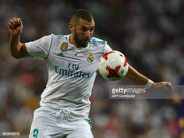 Real Madrid's French forward Karim Benzema controls the ball during the second leg of the Spanish Supercup football match Real Madrid vs FC Barcelona...