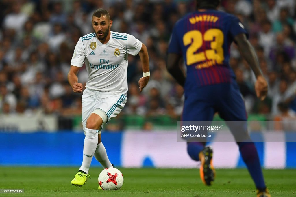 Real Madrid's French forward Karim Benzema controls the ball during the second leg of the Spanish Supercup football match Real Madrid vs FC Barcelona at the Santiago Bernabeu stadium in Madrid, on August 16, 2017. /
