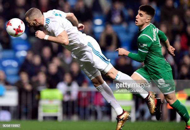 Real Madrid's French forward Karim Benzema dives to head the ball beside Leganes' Spanish defender Unai Bustinza during the Spanish 'Copa del Rey'...