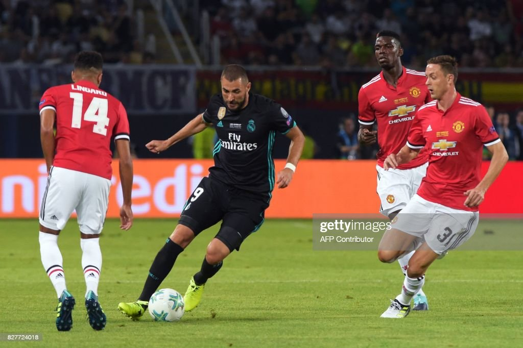 Real Madrid's French forward Karim Benzema (2nd-L) drives the ball next to Manchester United's Serbian midfielder Nemanja Matic (1st-R) during the UEFA Super Cup football match between Real Madrid and Manchester United on August 8, 2017, at the Philip II Arena in Skopje. /