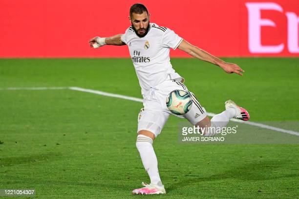 Real Madrid's French forward Karim Benzema eyes on the ball prior to shooting and scoring his second goal during the Spanish league football match...