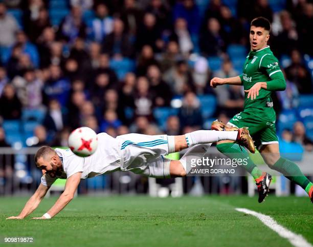 Real Madrid's French forward Karim Benzema falls on the field beside Leganes' Spanish defender Unai Bustinza during the Spanish 'Copa del Rey'...