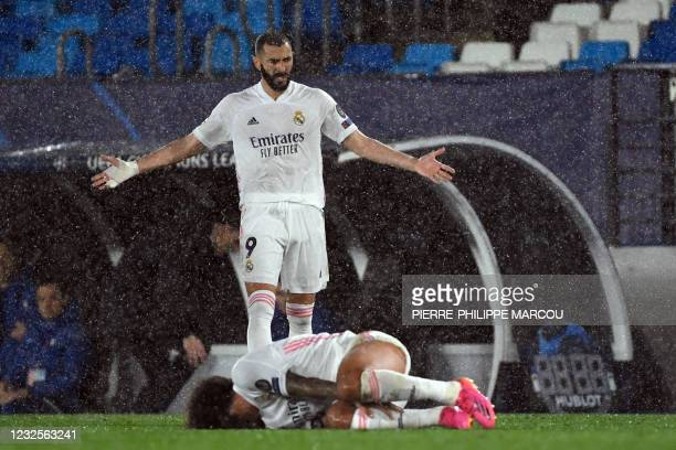 Real Madrid's French forward Karim Benzema gestures as Real Madrid's Brazilian defender Marcelo lays on the field during the UEFA Champions League...