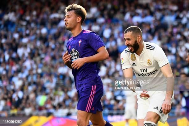 TOPSHOT Real Madrid's French forward Karim Benzema gestures beside Celta Vigo's Spanish defender Kevin Vazquez during the Spanish league football...