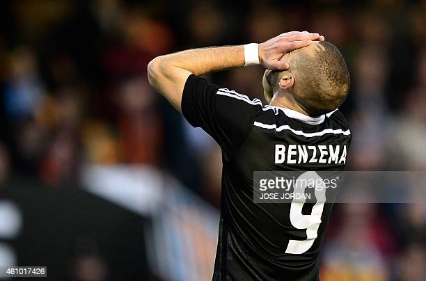 Real Madrid's French forward Karim Benzema gestures during the Spanish league football match Valencia CF vs Real Madrid CF at the Mestalla stadium in...