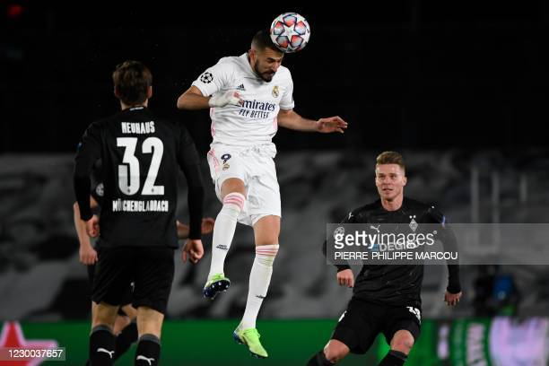 Real Madrid's French forward Karim Benzema heads the ball during the UEFA Champions League group B football match between Real Madrid and Borussia...