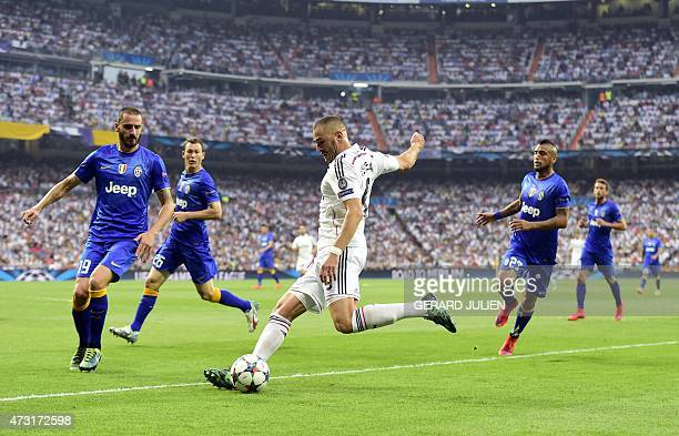 Real Madrid's French forward Karim Benzema kicks the ball past Juventus' defender Leonardo Bonucci during the UEFA Champions League semifinal second...