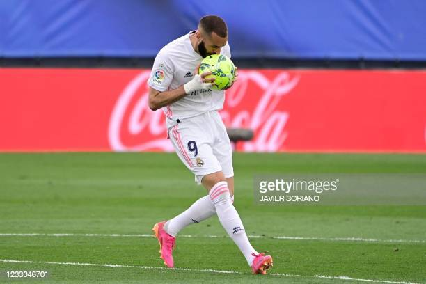 Real Madrid's French forward Karim Benzema kisses the ball after scoring a disallowed goal during the Spanish league football match Real Madrid CF...