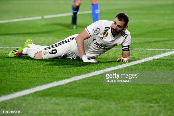 Real Madrid's French forward Karim Benzema lies on the field during the Spanish league football match between Getafe CF and Real Madrid CF at the Col...