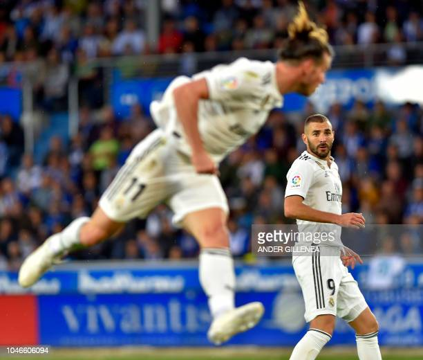 Real Madrid's French forward Karim Benzema looks at Real Madrid's Welsh forward Gareth Bale heading the ball during the Spanish league football match...
