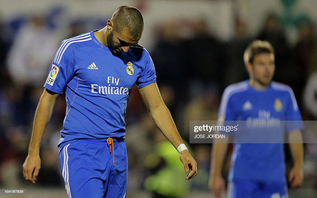 Real Madrid's French forward Karim Benzema reacts during the Spanish Copa del Rey (King's Cup) finals stage match Olimpic de Xativa vs Real Madrid CF at the La Murta stadium in Xativa on December 7, 2013.