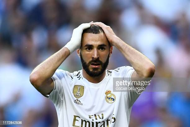 TOPSHOT Real Madrid's French forward Karim Benzema reacts during the UEFA Champions league Group A football match between Real Madrid and Club Brugge...