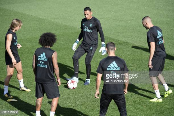 Real Madrid's French forward Karim Benzema Real Madrid's Costa Rican goalkeeper Keylor Navas and Real Madrid's Croatian midfielder Luka Modric take...