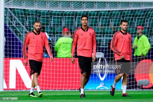 Real Madrid's French forward Karim Benzema Real Madrid's French defender Raphael Varane and Real Madrid's Spanish defender Nacho Fernandez take part...