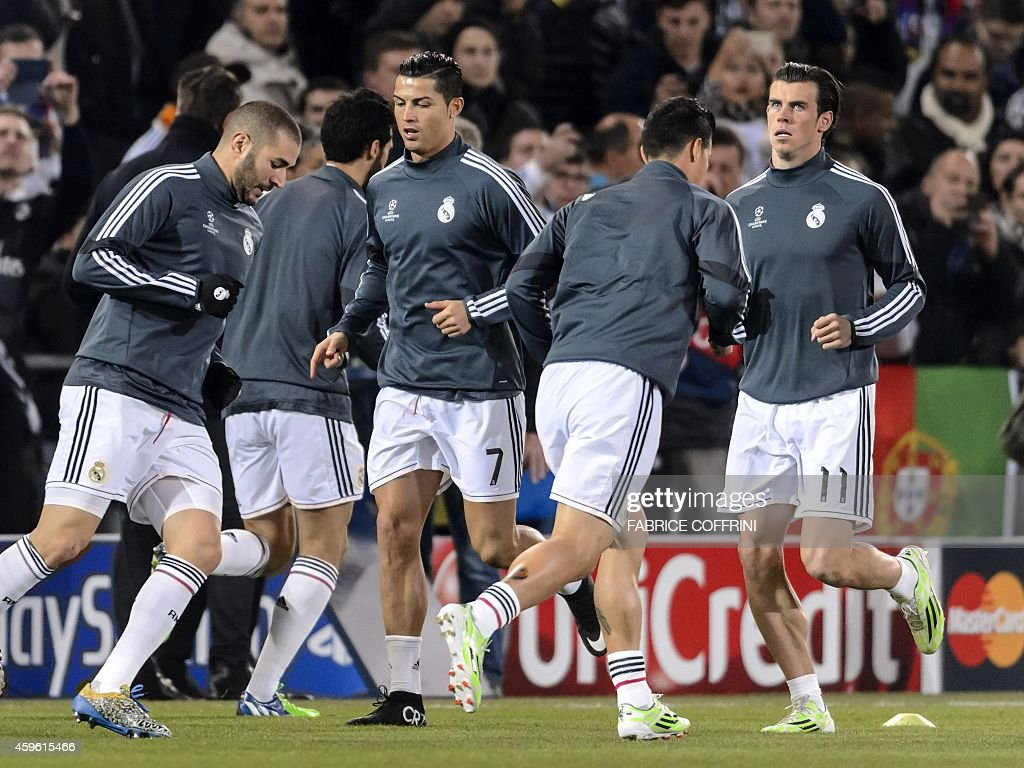 Real Madrid's French forward Karim Benzema (L), Real Madrid's Portuguese forward Cristiano Ronaldo (L) and Real Madrid's Welsh forward Gareth Bale (R) warm up on November 26, 2014 before a UEFA Champions League Group B football match between FC Basel and Real Madrid in Basel.