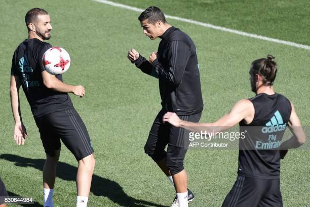 Real Madrid's French forward Karim Benzema Real Madrid's Portuguese forward Cristiano Ronaldo Real Madrid's Welsh forward Gareth Bale take part in a...