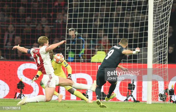 Real Madrid's French forward Karim Benzema scores a goal during the UEFA Champions league round of 16 first leg football match between Ajax Amsterdam...