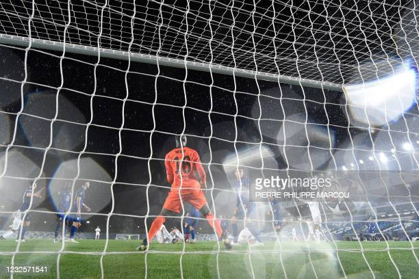 Real Madrid's French forward Karim Benzema scores a goal during the UEFA Champions League semi-final first leg football match between Real Madrid and...