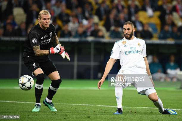 Real Madrid's French forward Karim Benzema scores a goal past Liverpool's German goalkeeper Loris Karius during the UEFA Champions League final...