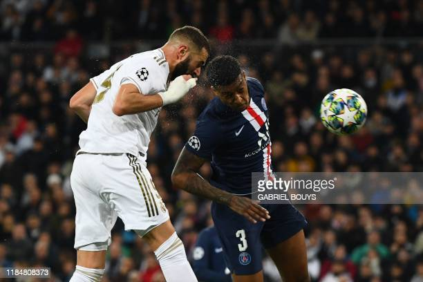 Real Madrid's French forward Karim Benzema scores during the UEFA Champions League group A football match Real Madrid against Paris Saint-Germain FC...