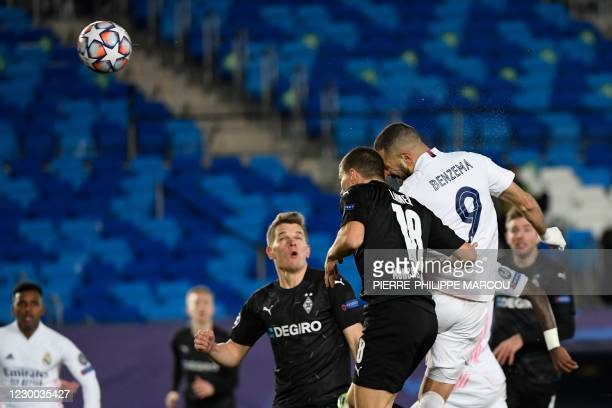 Real Madrid's French forward Karim Benzema scores during the UEFA Champions League group B football match between Real Madrid and Borussia...