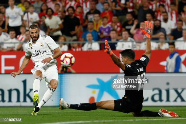 TOPSHOT Real Madrid's French forward Karim Benzema shoots against Girona's Moroccan goalkeeper Yassine Bounou during the Spanish league football...