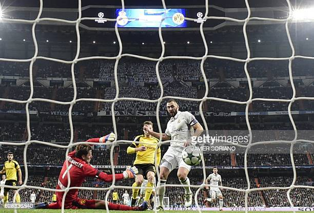 Real Madrid's French forward Karim Benzema shoots to score a goal in front of Dortmund's goalkeeper Roman Weidenfeller during the UEFA Champions...