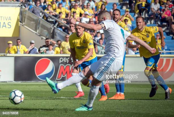 Real Madrid's French forward Karim Benzema shoots to score a goal during the Spanish League football match between UD Las Palmas and Real Madrid CF...