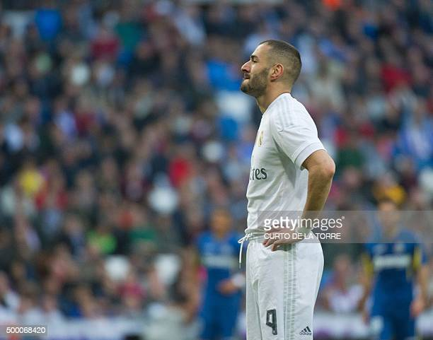 Real Madrid's French forward Karim Benzema stands during the Spanish league football match Real Madrid CF vs Getafe CF at the Santiago Bernabeu...