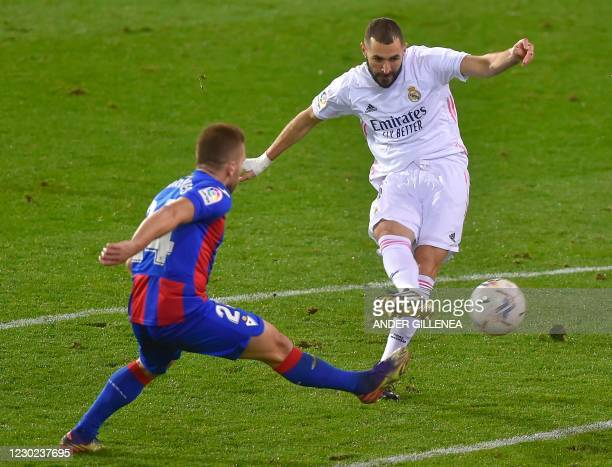 Real Madrid's French forward Karim Benzema vies with Eibar's French defender Kevin Rodrigues during the Spanish league football match between SD...