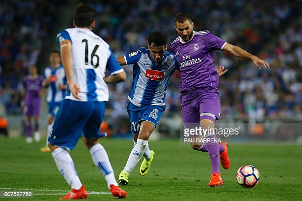 Real Madrid's French forward Karim Benzema vies with Espanol's Paraguayan midfielder Hernan Perez during the Spanish league football match RCD...